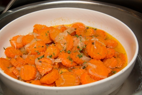 Carrots with butter in a white bolw